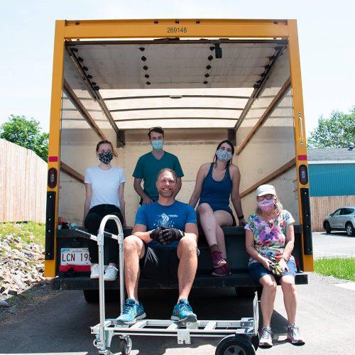 Volunteer movers in back of truck