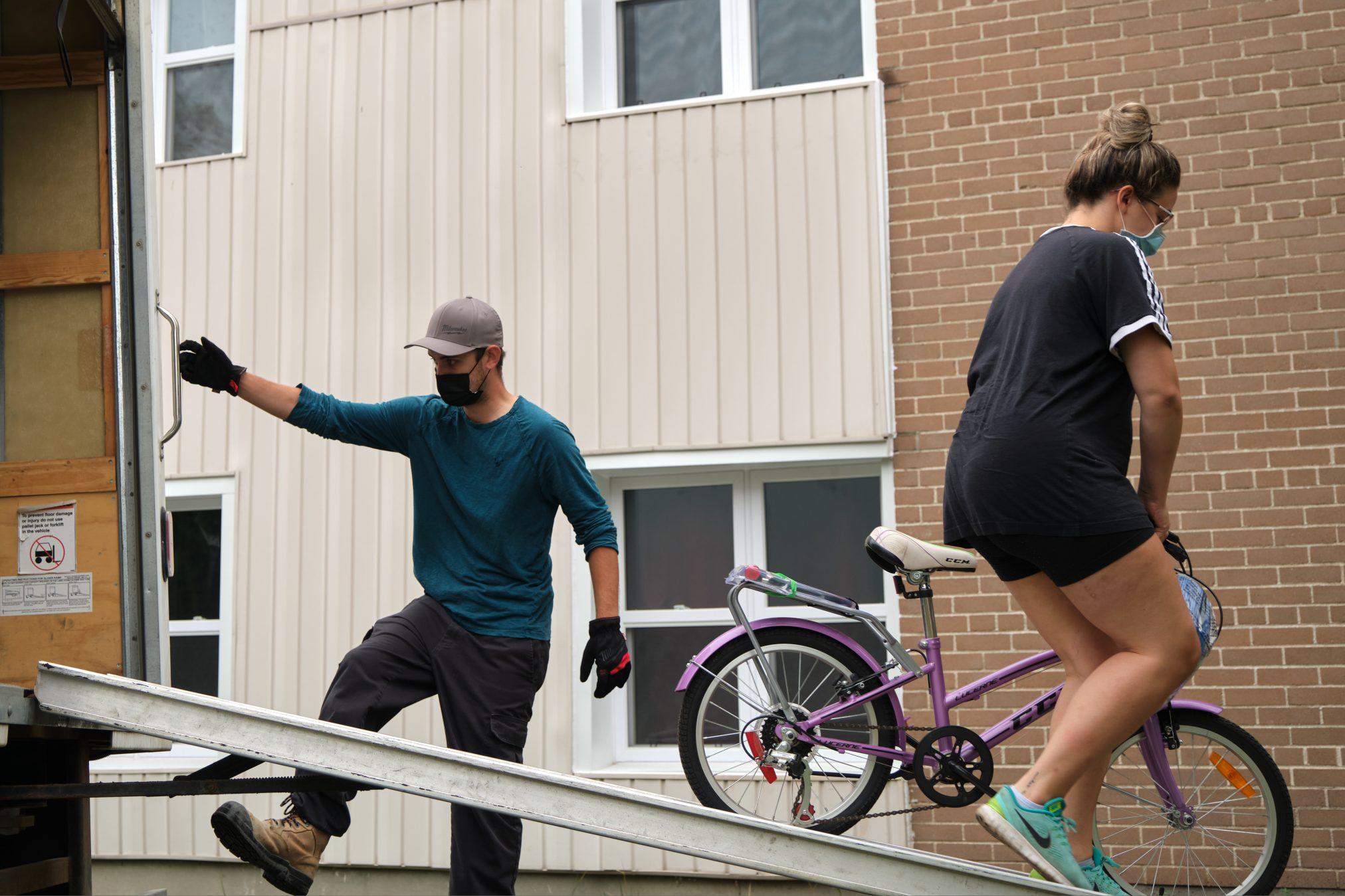 Volunteer movers unloading a truck